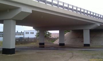 Road overpass – repair of load carrying structure and pillars – ensuring correct reinforcement concrete surrounding
